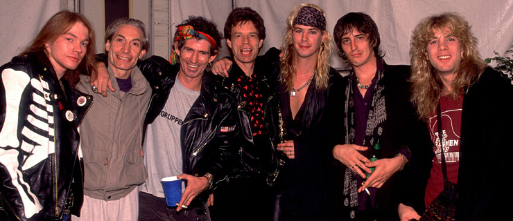 Rolling Stones e Guns N' Roses: Axl Rose, Charlie Watts, Keith Richards, Mick Jagger, Duff McKagan, Izzy Stradlin e Steven Adler na Steel Wheels Tour em 1989 - Los Angeles (EUA) - Paul Natkin/Image Direct